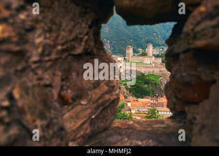 View of beautiful town of Bellinzona in Switzerland with Castelgrande from the stone wall of Montebello castle - Stock Photo