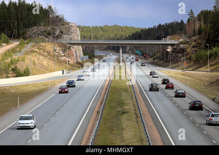 Motorway traffic on an overcast day of spring on Finnish National Road 1 in Salo, Finland - April 28, 2018. - Stock Photo