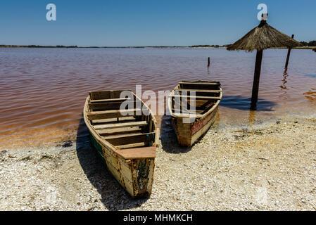 Senegal's pink water lake called Lake Retba or Lac Rose, north of the Cap Vert peninsula of Senegal, north east of Dakar - Stock Photo