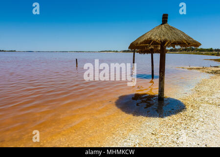 Senegal's pink water lake called Lake Retba or Lac Rose, north of the Cap Vert peninsula of Senegal, north east of Dakar - Stock Photo