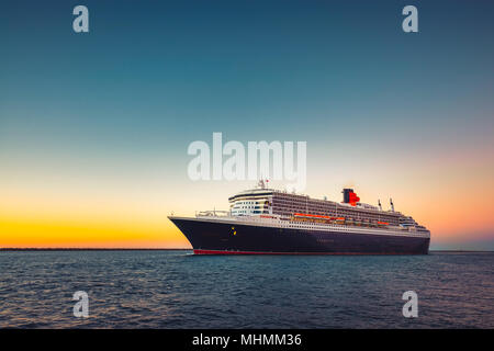 Adelaide, Australia - February 16, 2018: Cunard Line RMS Queen Mary 2 flagship with people on board leaving Outer Harbour in Port Adelaide for cruise  - Stock Photo