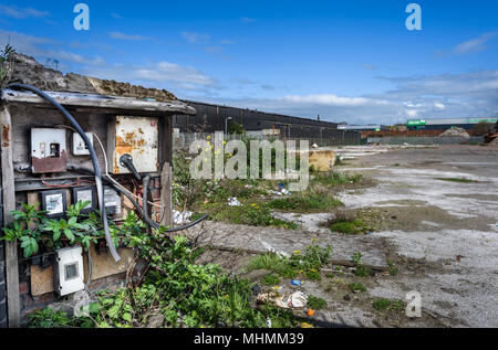 Old electrical switch and fuses on an abandoned industrial site. - Stock Photo