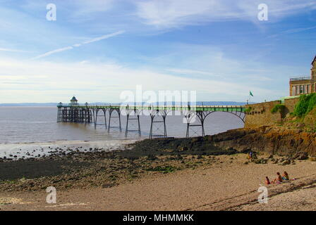View of the pier in the seaside resort of Clevedon in the county of Avon.  The pier opened in 1869.  Much repair and restoration work has been carried out since then, and the pier is now a Grade I listed building.       Date: August 2008 - Stock Photo