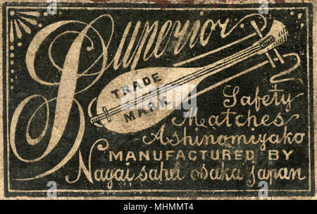 Old Japanese Matchbox label with a mandolin for Superior Trademark safety matches Ashinomiyako manufactured by Nayai Sahu Osaka in Japan for the Chinese market     Date: c. 1910s - Stock Photo
