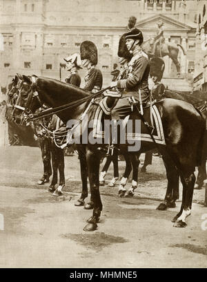 Prince Albert, Duke of York (future King George VI) (1895-1952) - July 1922 - regments of the Brigade of Guards receive new colours from King Gerge V - picture from the march after the ceremony which featured Prince Albert (foreground) and his Brother the Prince of Wales (later King Edward VIIII) in the busby hat directly behind him     Date: 1922 - Stock Photo