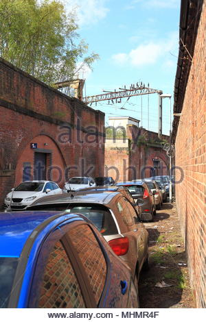 Cars Parked On The Narrow Back Streets Of Ardwick Greater Manchester At The Ardwick Railway Station Platform - Stock Photo