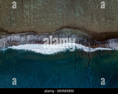 Rarotonga waves on the reef Polynesia Cook Islands tropical paradise aerial view panorama landscape - Stock Photo