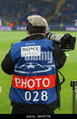KHARKIV, UKRAINE - FEBRUARY 21, 2018: Sport photographer at work during UEFA Champions League Round of 16 game Shakhtar v Roma at OSK Metalist stadium - Stock Photo