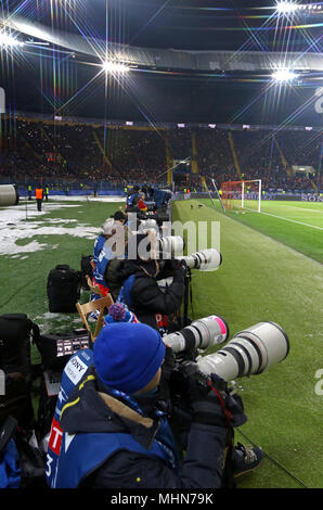 KHARKIV, UKRAINE - FEBRUARY 21, 2018: Sport photographers at work during UEFA Champions League Round of 16 game Shakhtar v Roma at OSK Metalist stadiu - Stock Photo