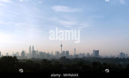 panorama view of beautiful kuala lumpur cityscape skyline in the hazy or foggy morning enviroment and buildings in silhouette with copy space - Stock Photo
