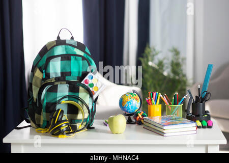 The school backpack is on the table. School supplies - Stock Photo