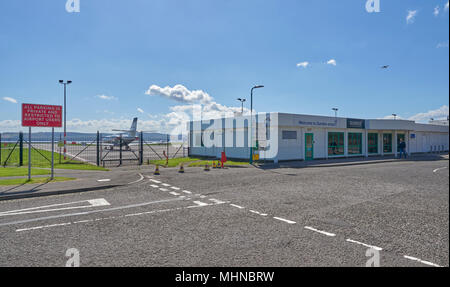 A person walking in front of Dundee Terminal at Dundee airport on a Bright Spring Day. Angus, Scotland. - Stock Photo