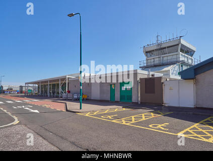 The Control Tower and Terminal Building at Dundee Airport, on the Tay Estuary on one fine Spring day in  Angus, Scotland. - Stock Photo