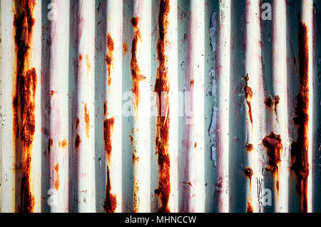 Weathered corrugated rusty metal painted wall, abstract background. - Stock Photo
