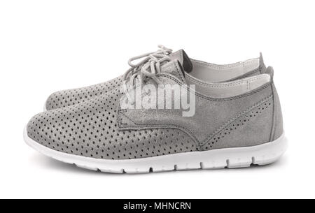 Side view of grey leather sport shoes isolated on white - Stock Photo
