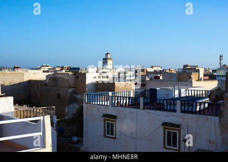View over the old town medina rooftops towards the Ben Youssef mosque, Essaouira, Morocco, Africa. - Stock Photo