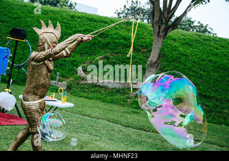 Man in disguise making a big bubble - Stock Photo