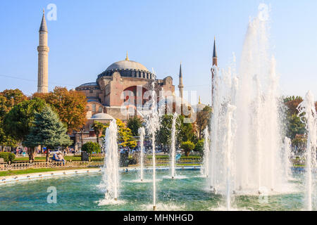 Istanbul, Turkey-8th October 2011: The Sultan Ahmad Maydan Fountain with Hagia Sophia in background, The fountain is situated in Sultanhamet Square. - Stock Photo