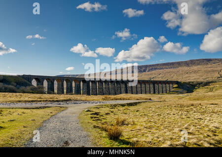 A distant view of the Ribblehead viaduct, on a sunny day - Stock Photo