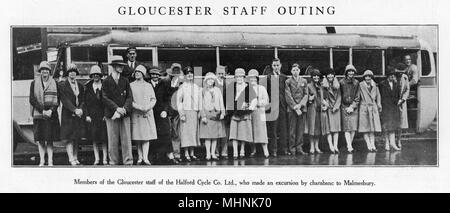 Gloucester staff members of the Halford Cycle Co. Ltd about to set out on an outing by charabanc to Malmesbury.     Date: late 1920s - Stock Photo