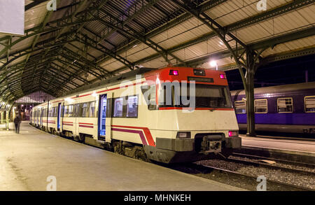 Spanish suburban electric train at French border station Cerbere - Stock Photo