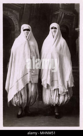Algeria - Two Moorish women in traditional costume     Date: circa 1910s - Stock Photo