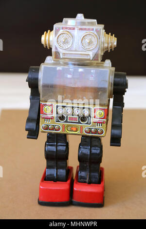 Retro Toy Walking Plastic Robot with Clear See-through body and digital-style display panel. - Stock Photo