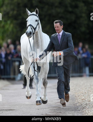 Sir Mark Todd with Kiltubrid Rhapsody in the trot up during day one of the Mitsubishi Motors Badminton Horse Trials at The Badminton Estate, Gloucestershire. - Stock Photo