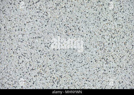 Background texture of polished stone showing the random distribution of constituent minerals forming a speckled pattern - Stock Photo