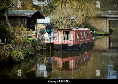 Moored narrow boats on moorings at a private back garden  at the Peak Forest Canal in the High peak at Whaley Bridge in Derbyshire, England - Stock Photo