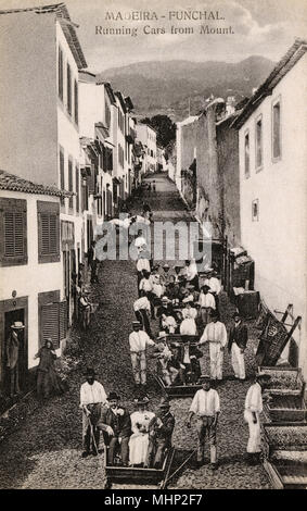 Street scene with tourist cars in Funchal, Madeira, sliding down the steep slope from top to bottom.      Date: circa 1910