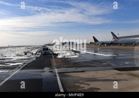 PARIS, FRANCE - FEBRUARY 10 2018 - paris airport covered by snow big delays and flights cancelled - Stock Photo