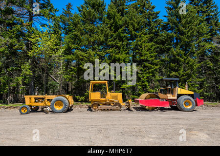 Earth Movers at Road Contruction Site in Forest - Stock Photo