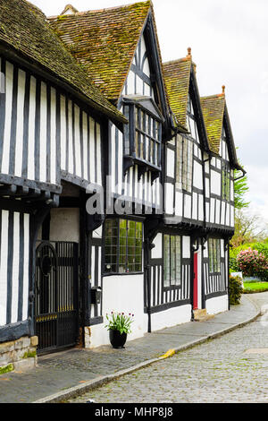 Medieval timbered houses in cobbled street. Mill Street, Warwick, Warwickshire, West Midlands, England, UK, Britain - Stock Photo