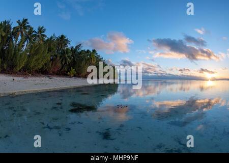 Aitutaki island Polynesia beach Wonderful red sunset in cook islands - Stock Photo