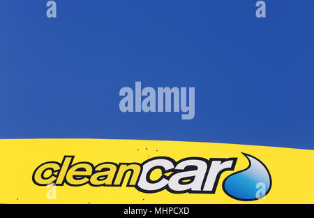 Salem, Sweden - May 29, 2014: Close up of the logo on the side of the roof of the Clean Car unmanned car washes in Sweden for self-service, against a  - Stock Photo