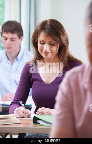 Mature Woman In Adult Education Class - Stock Photo