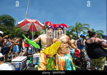 Rio de Janeiro, Brazil - February 11, 2018: Young Brazilian revelers smile for the camera at a carnival street party - Stock Photo