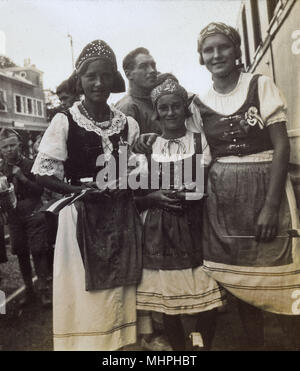 Women in national costume (possibly Norwegian or Austrian).      Date: circa 1920s - Stock Photo