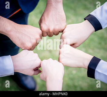 hand and Fists circle together for team concept - Stock Photo