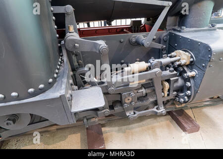 Linkage under a train in Ipswich Railway Workshops - Stock Photo
