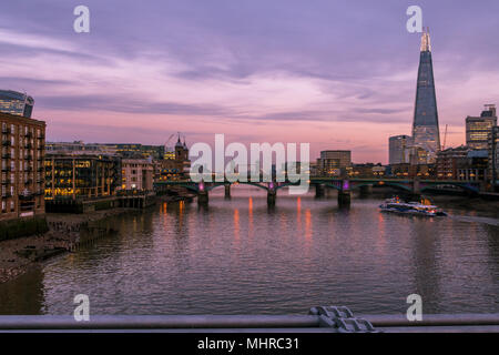 London city skyline.  A cityscape pf the River Thames featuring the Shard building and Tower Bridge, as viewed from the Millennium Bridge - Stock Photo