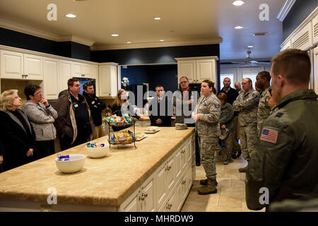 Tech. Sgt. Dorothy Whitfield, NCO in charge of the Dover Fisher House, shows Team Dover's honorary commanders the Fisher House March 14, 2018, at Dover Air Force Base, Del. Honorary commanders experience all aspects of the base and its daily operations during their year in the position. (U.S. Air Force - Stock Photo