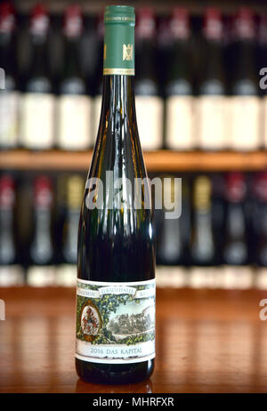 01 May 2018, Trier, Germany: A bottle of Riesling wine 'Das Kapital' (lit. The Capital). The wine originates from the vineyard of Karl Marx' Family. The Marx family has owned more than two hectares of vines for about 30 years. Photo: Harald Tittel/dpa - Stock Photo