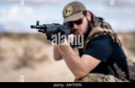 In a post-apocalyptic desert wasteland, a Queen of the Apocalypse leads her militia against the enemy. Armed to the teeth, who will win? - Stock Photo