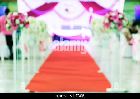 Blur Beautiful flowers background for wedding scene,Happy outdoor Wedding Ceremony Scene for a summer mountain wedding,decorated wedding alter and flo - Stock Photo
