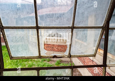 broken windows glass in ellis island abandoned psychiatric hospital interior rooms view - Stock Photo