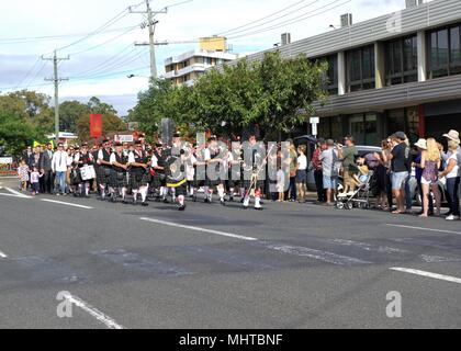 Pipes and drums band marching in ANZAC Day parade at Coffs Harbour in Australia - Stock Photo