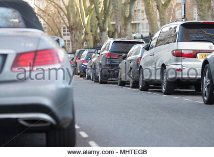 File photo dated of 16/01/16 of cars parked on a street. Insurer Admiral found that nearly two-thirds of motorists feel awkward about asking passengers for petrol money in return for a lift. - Stock Photo