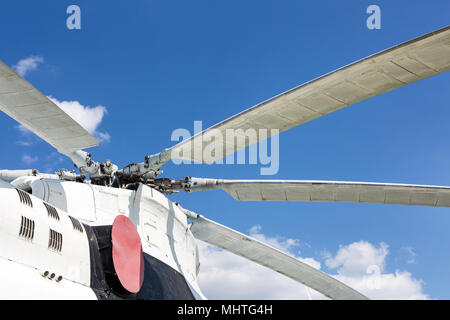 Close-up  blade rotors of big cargo-passenger helicopter against blue sky on background - Stock Photo